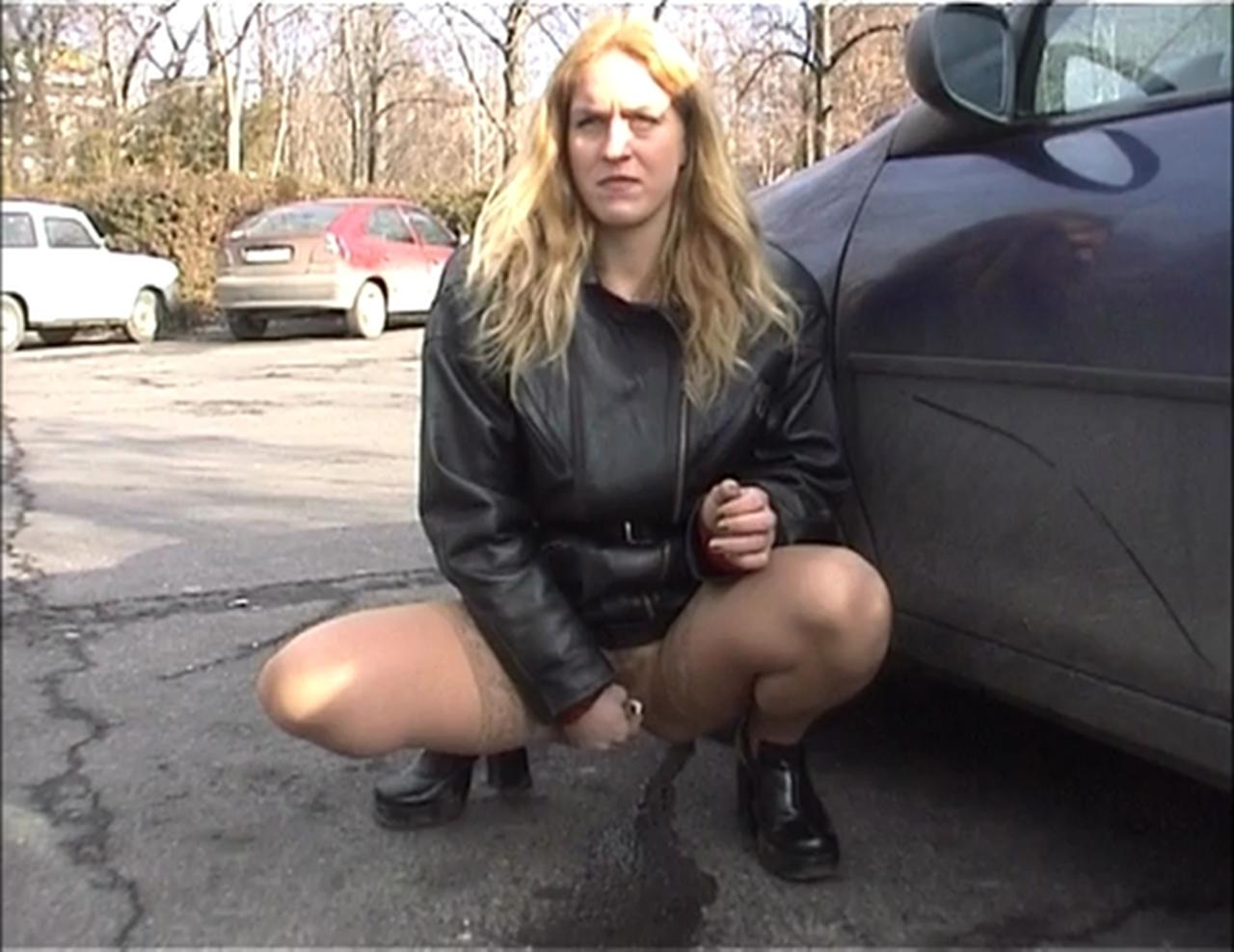 girl peeing in parking lot